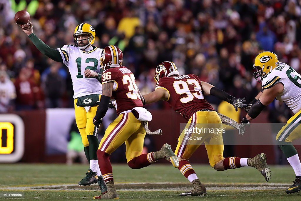 Quarterback Aaron Rodgers #12 of the Green Bay Packers passes the ball while under pressure by inside linebacker Su'a Cravens #36 and defensive end Trent Murphy #93 of the Washington Redskins in the second quarter at FedExField on November 20, 2016 in Landover, Maryland.