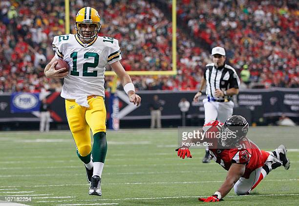 Quarterback Aaron Rodgers of the Green Bay Packers rushes upfield away from Corey Peters of the Atlanta Falcons at Georgia Dome on November 28, 2010...