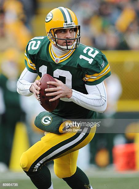 Quarterback Aaron Rodgers of the Green Bay Packers scrambles during an NFL game against the Houston Texans at Lambeau Field on December 7 2008 in...