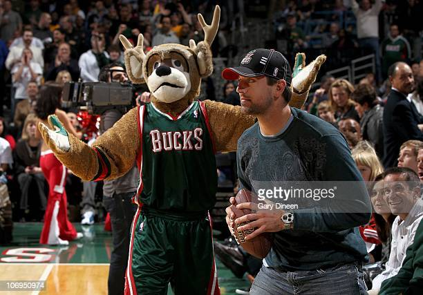 Quarterback Aaron Rodgers of the Green Bay Packers stands on the court with Bucks mascot Bango during the game between the Los Angeles Lakers and the...