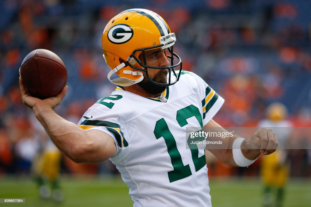 Quarterback Aaron Rodgers #12 of the Green Bay Packers warms up before a Preseason game against the Denver Broncos at Sports Authority Field at Mile High on August 26, 2017 in Denver, Colorado.