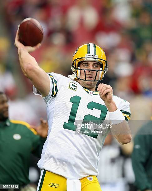 Quarterback Aaron Rodgers of the Green Bay Packers warms up before the 2010 NFC wild-card playoff game against the Arizona Cardinals at the...