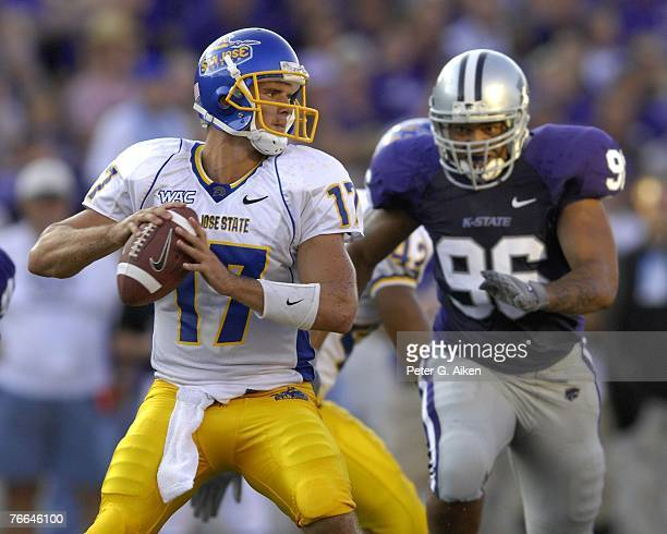 Quarterback Adam Tafralis of the San Jose State Spartans looks to pass against defender Moses Manu of the Kansas State Wildcats during a NCAA...