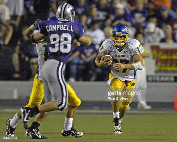 Quarterback Adam Tafralis of the San Jose State Spartans rushes up field against pressure from linebacker Ian Campbell of the Kansas State Wildcats...