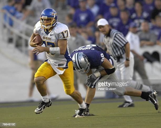 Quarterback Adam Tafralis of the San Jose State Spartans rushes up field past linebacker Ian Campbell of the Kansas State Wildcats during a NCAA...