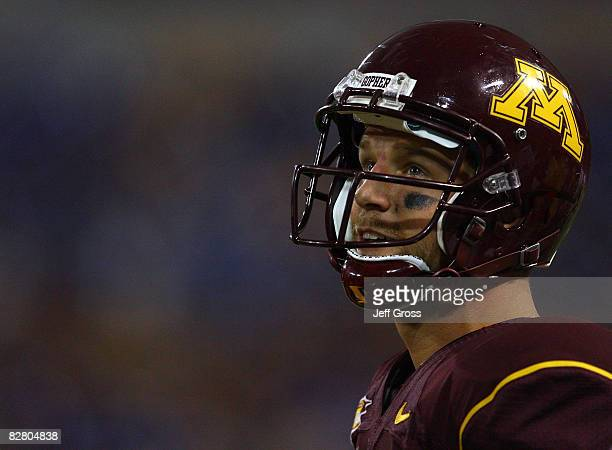 Quarterback Adam Weber of the Minnesota Golden Gophers looks on from the sideline against the Montana State Bobcats at the Metrodome on September 13...