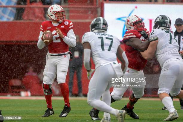Quarterback Adrian Martinez of the Nebraska Cornhuskers drops back to pass against the Michigan State Spartans at Memorial Stadium on November 17...