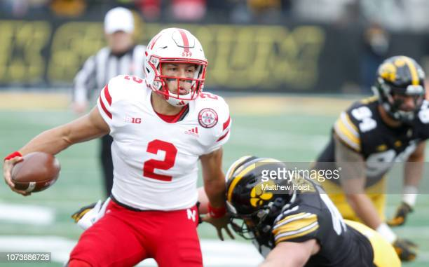 Quarterback Adrian Martinez of the Nebraska Cornhuskers is tackled in the first half by defensive end Parker Hesse of the Iowa Hawkeyes on November...