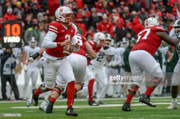 Quarterback Adrian Martinez of the Nebraska Cornhuskers looks to pass against the Michigan State Spartans at Memorial Stadium on November 17 2018 in...