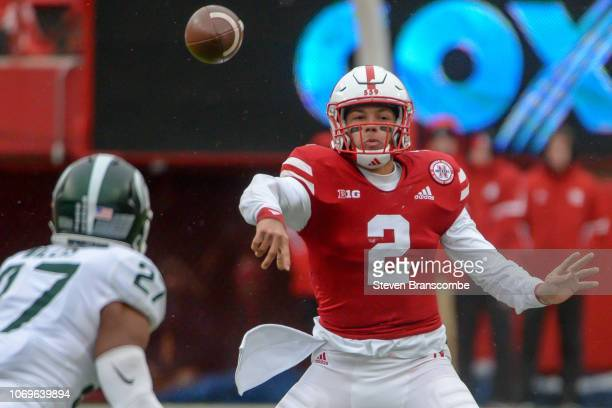 Quarterback Adrian Martinez of the Nebraska Cornhuskers passes against the Michigan State Spartans at Memorial Stadium on November 17 2018 in Lincoln...