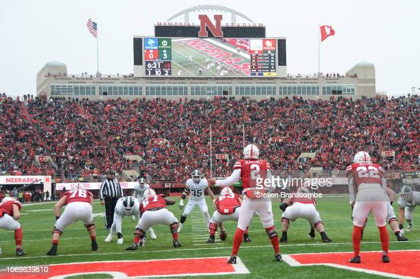 Quarterback Adrian Martinez of the Nebraska Cornhuskers prepares to take a snap against the Michigan State Spartans at Memorial Stadium on November...
