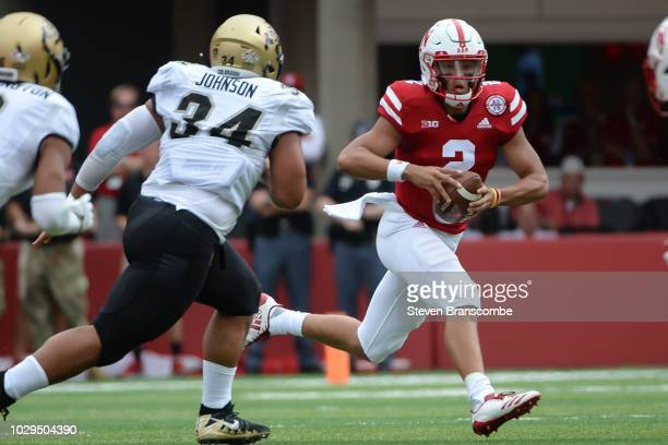 Quarterback Adrian Martinez of the Nebraska Cornhuskers runs against defensive lineman Mustafa Johnson of the Colorado Buffaloes in the first half at...