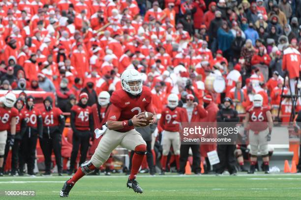 Quarterback Adrian Martinez of the Nebraska Cornhuskers runs against the Illinois Fighting Illini in the second half at Memorial Stadium on November...