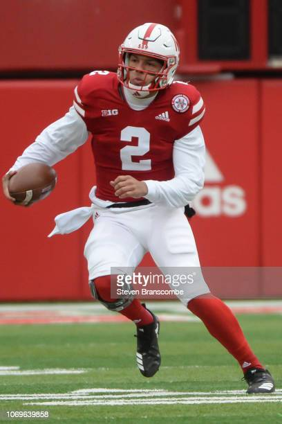 Quarterback Adrian Martinez of the Nebraska Cornhuskers runs against the Michigan State Spartans at Memorial Stadium on November 17 2018 in Lincoln...