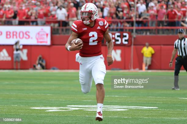 Quarterback Adrian Martinez of the Nebraska Cornhuskers runs in the open field in the game against the Colorado Buffaloes at Memorial Stadium on...