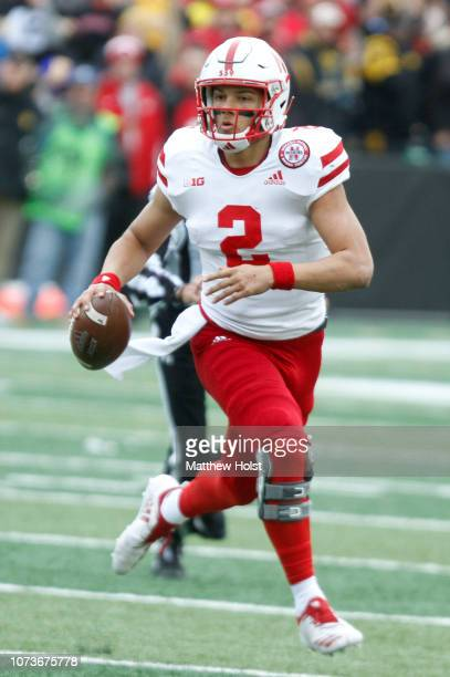 Quarterback Adrian Martinez of the Nebraska Cornhuskers scrambles in the first half against the Iowa Hawkeyes on November 23 2018 at Kinnick Stadium...