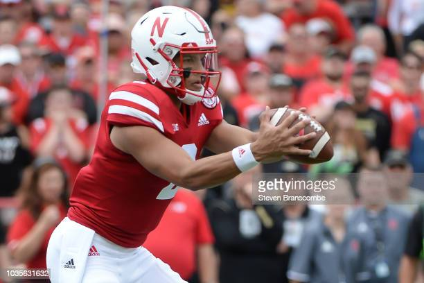 Quarterback Adrian Martinez of the Nebraska Cornhuskers takes a snap against the Colorado Buffaloes at Memorial Stadium on September 8 2018 in...