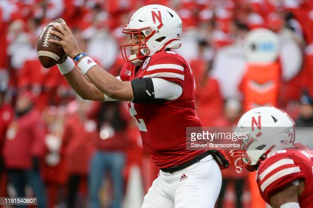 Quarterback Adrian Martinez of the Nebraska Cornhuskers takes the snap against the Iowa Hawkeyes at Memorial Stadium on November 29, 2019 in Lincoln,...