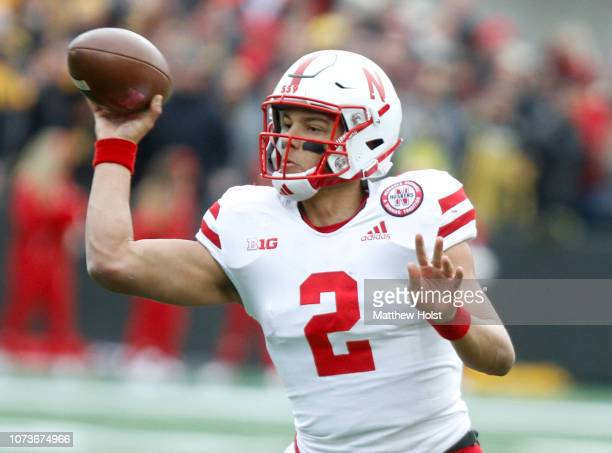 Quarterback Adrian Martinez of the Nebraska Cornhuskers throws a pass in the first half against the Iowa Hawkeyes on November 23 2018 at Kinnick...