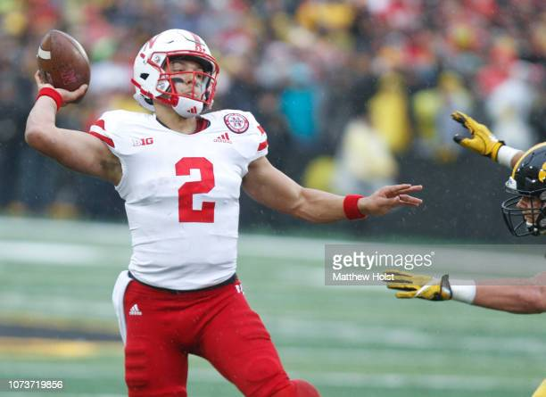 Quarterback Adrian Martinez of the Nebraska Cornhuskers throws a pass in the second half against the Iowa Hawkeyes on November 23 2018 at Kinnick...