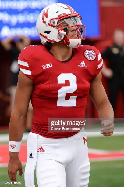 Quarterback Adrian Martinez of the Nebraska Cornhuskers warms up before the game against the Akron Zips at Memorial Stadium on September 1 2018 in...