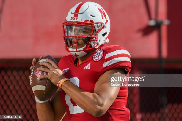 Quarterback Adrian Martinez of the Nebraska Cornhuskers warms up before the game against the Troy Trojans at Memorial Stadium on September 15 2018 in...