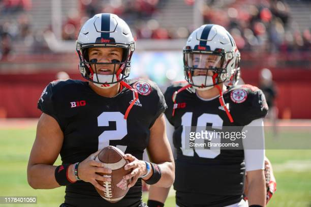 Quarterback Adrian Martinez of the Nebraska Cornhuskers warms up with quarterback Noah Vedral before the game against the Indiana Hoosiers at...