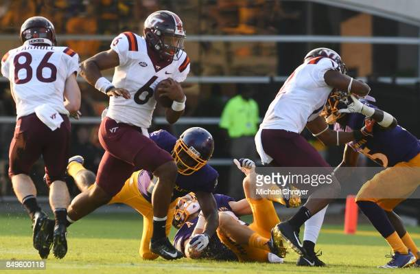 Quarterback AJ Bush of the Virginia Tech Hokies carries the ball against the East Carolina Pirates in the second half at DowdyFicklen Stadium on...