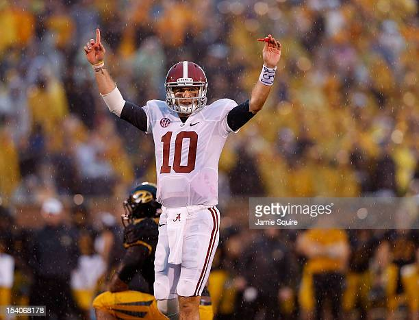 Quarterback AJ McCarron of the Alabama Crimson Tide celebrates after Alabama scored a touchdwon during the 1st half of the game against the Missouri...