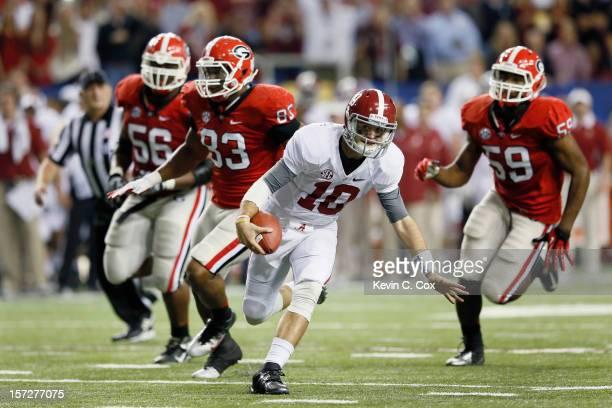 Quarterback AJ McCarron of the Alabama Crimson Tide scrambles for extra yardage against the Georgia Bulldogs late in the second quarter during the...