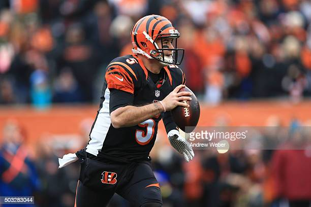 Quarterback AJ McCarron of the Cincinnati Bengals scrambles out of the pocket during the first quarter against the Baltimore Ravens at Paul Brown...