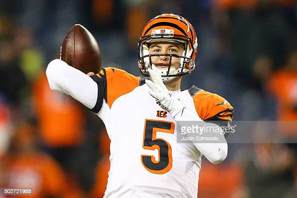 Quarterback AJ McCarron of the Cincinnati Bengals throws as he warms up before a game against the Denver Broncos at Sports Authority Field at Mile...