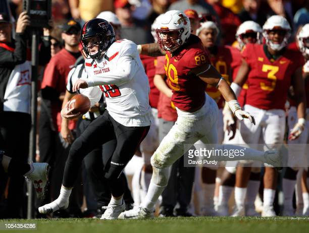 Quarterback Alan Bowman of the Texas Tech Red Raiders srambles under pressure from defensive end Matt Leo of the Iowa State Cyclones in the second...