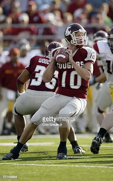 Quarterback Alex Brink of the Washington State Cougars drops back to pass against the USC Trojans on September 30 2006 at Martin Stadium in Pullman...