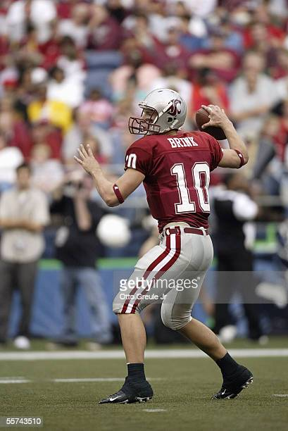 Quarterback Alex Brink of the Washington State University Cougars looks to pass during a NCAA game against the Grambling State University Tigers at...