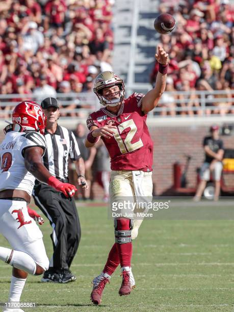 Quarterback Alex Hornibrook of the Florida State Seminoles on a passing play over Linebacker Boosie Whitlow of the Louisville Cardinals during the...