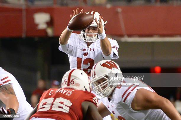 Quarterback Alex Hornibrook of the Wisconsin Badgers fields a snap against the Nebraska Cornhuskers at Memorial Stadium on October 7 2017 in Lincoln...