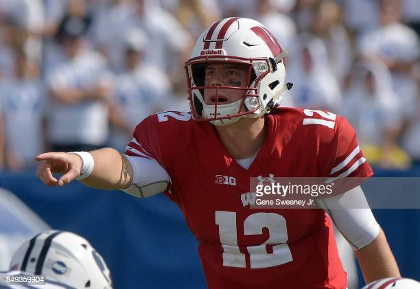 Quarterback Alex Hornibrook of the Wisconsin Badgers gestures behind the line during a game against the BYU Cougars at LaVell Edwards Stadium on...