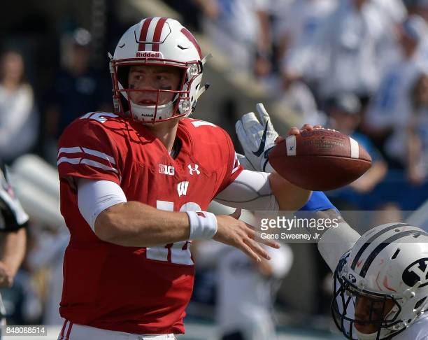 Quarterback Alex Hornibrook of the Wisconsin Badgers looks to pass the ball in the second half of their 406 win over the Brigham Young Cougars at...
