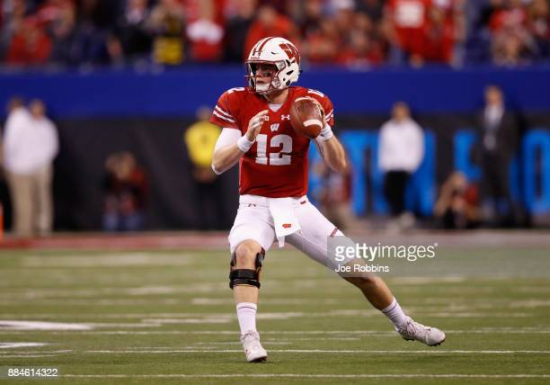 Quarterback Alex Hornibrook of the Wisconsin Badgers looks to pass against the Ohio State Buckeyes in the second half during the Big Ten Championship...