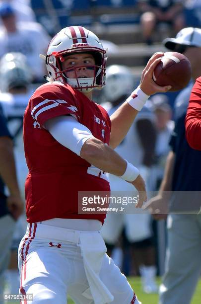 Quarterback Alex Hornibrook of the Wisconsin Badgers looks to throw the ball during practice prior to their game against the Brigham Young Cougars at...