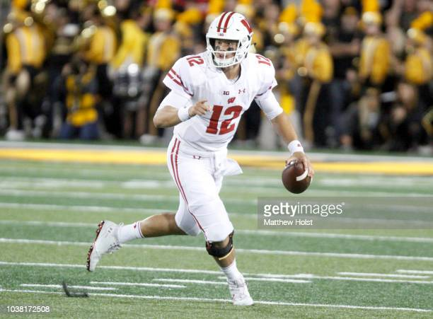 Quarterback Alex Hornibrook of the Wisconsin Badgers scrambles on a keeper in the first half against the Iowa Hawkeyes on September 22 2018 at...