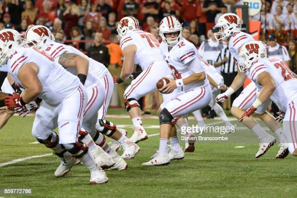 Quarterback Alex Hornibrook of the Wisconsin Badgers takes a snap against the Nebraska Cornhuskers at Memorial Stadium on October 7 2017 in Lincoln...