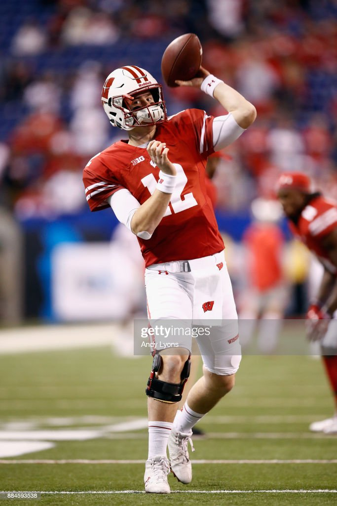 Quarterback Alex Hornibrook #12 of the Wisconsin Badgers throws a pass while warming up before playing against the Ohio State Buckeyes at Lucas Oil Stadium on December 2, 2017 in Indianapolis, Indiana.