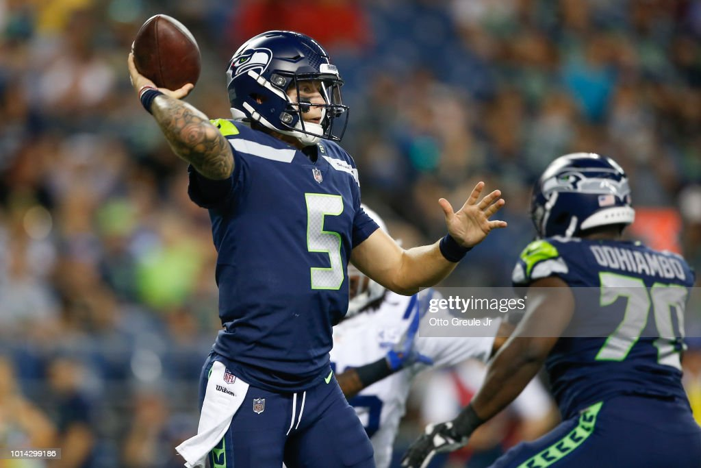 Quarterback Alex McGough #5 of the Seattle Seahawks passes against the Indianapolis Colts at CenturyLink Field on August 9, 2018 in Seattle, Washington.