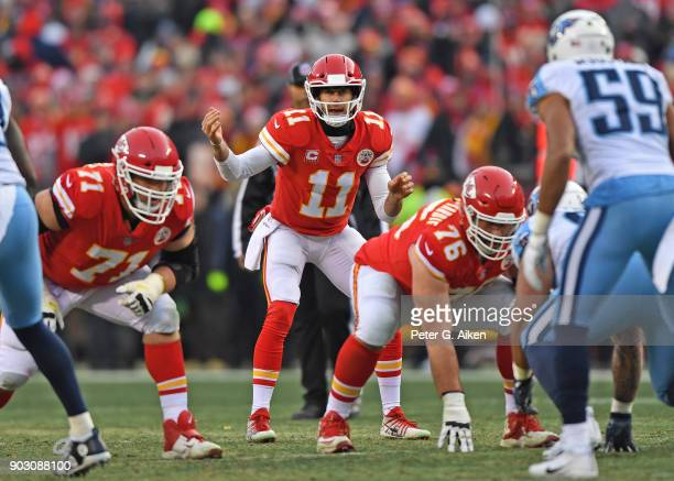 Quarterback Alex Smith of the Kansas City Chiefs calls out instructions at the line during the first half of the game against the Tennessee Titans at...