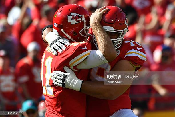 Quarterback Alex Smith of the Kansas City Chiefs celebrates a touchdown pass with Laurent DuvernayTardif at Arrowhead Stadium during the second...