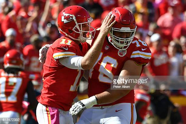 Quarterback Alex Smith of the Kansas City Chiefs celebrates a touchdown pass with Laurent Duvernay-Tardif at Arrowhead Stadium during the second...