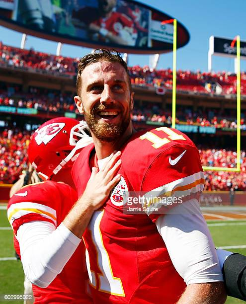 Quarterback Alex Smith of the Kansas City Chiefs celebrates after scoring a touchdown as the Chiefs defeat the San Diego Chargers 3327 to win the...