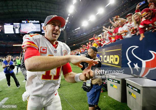 Quarterback Alex Smith of the Kansas City Chiefs celebrates their 300 win over the Houston Texans during the AFC Wild Card Playoff game at NRG...